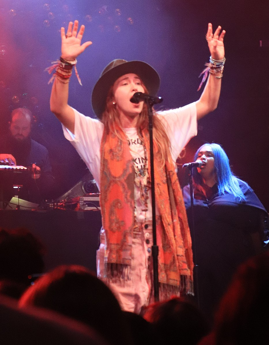 singer lauren daigle performing at a concert