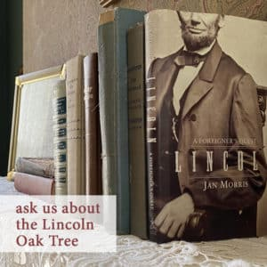 several antique books on a fireplace mantle including one about Abraham Lincoln