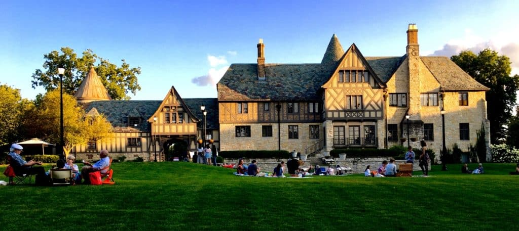 Ewing Manor with first groups of people setting up on lawn for Illinois Shakespeare Festival