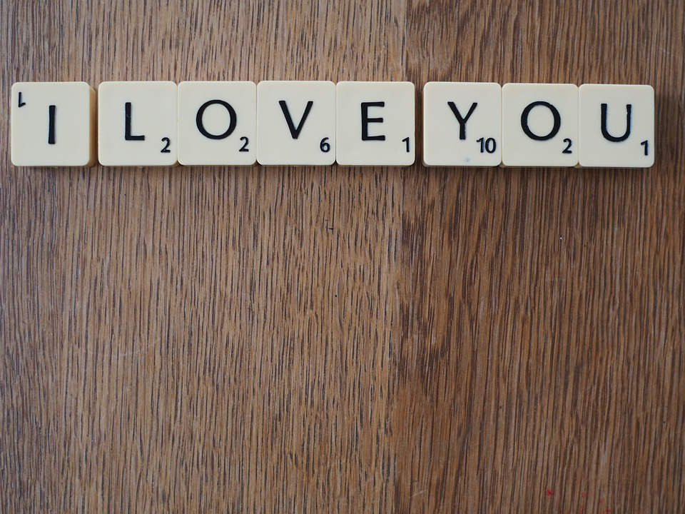 White scrabble letter blocks spelling out I LOVE YOU