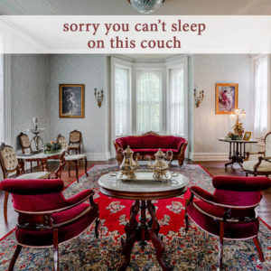 antique red velvet chairs and couch in the parlor