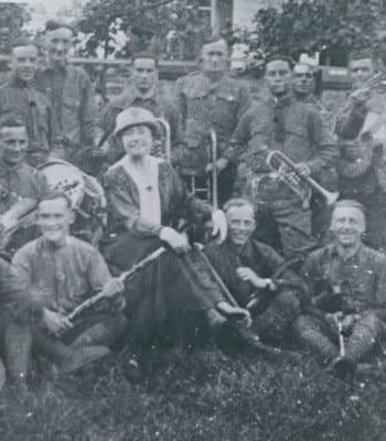 Old black and white photograph of smiling men and women with instruments from Vrooman's jazz band