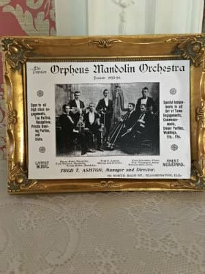 Old black and white photograph of the Orpheus Mandolin Orchestra in an antique gilded frame