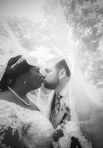 sharing a kiss under her veil